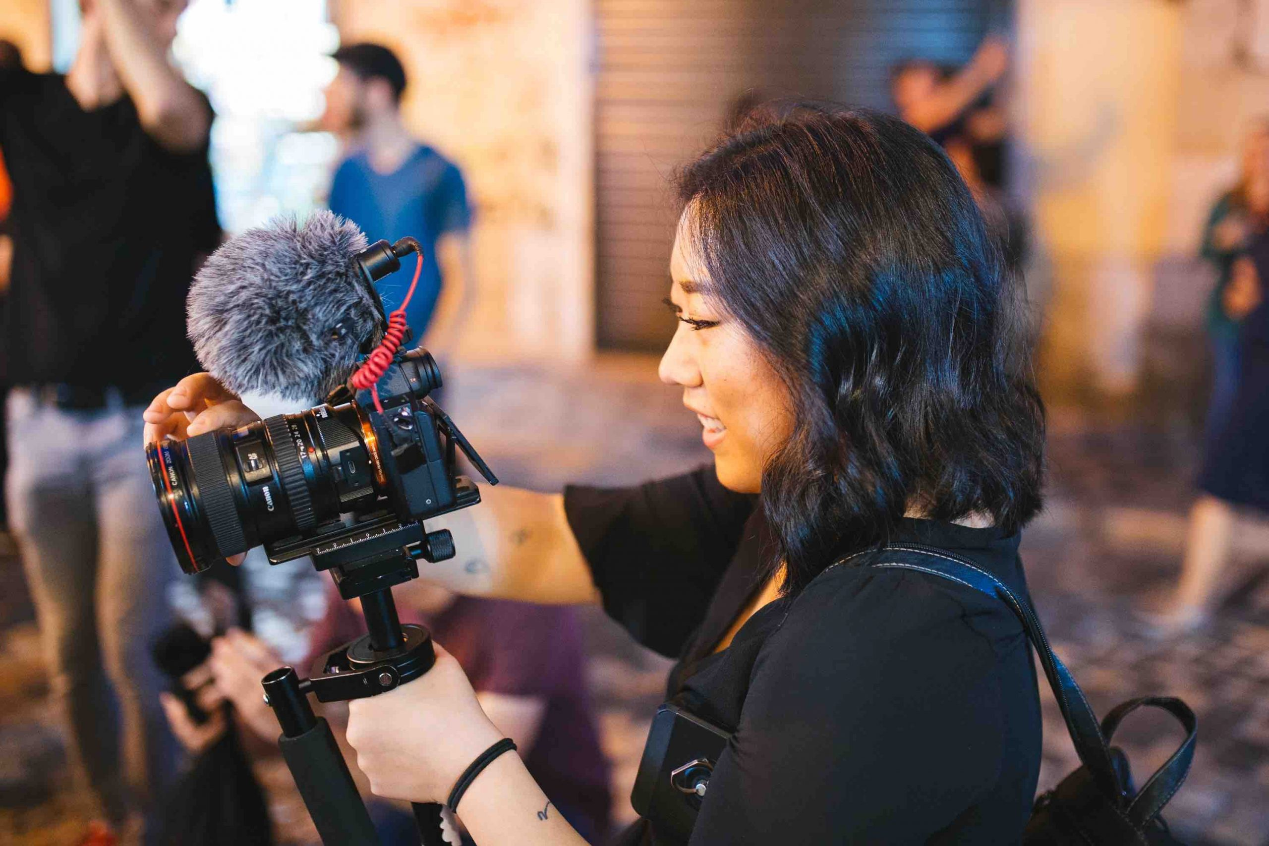 In the next normal, video content is a highly effective medium. That's exactly what this young woman is doing, shooting an event with her videocam